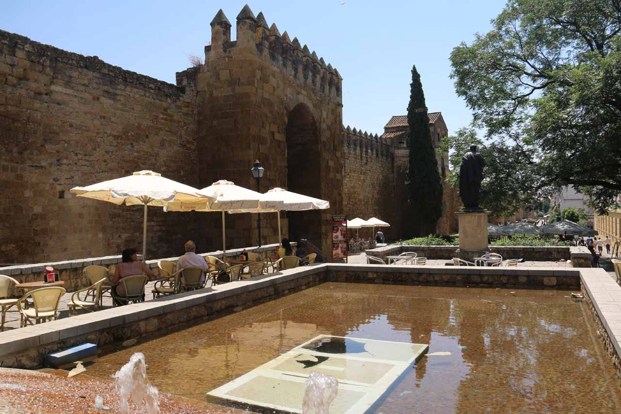 Old walls, fountains, and a cafe by the Puerta de Almodovar
