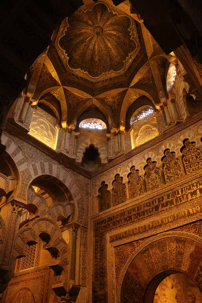 Looking up at some tall and elaborate room fronting the popular prayer room inside la Mezquita