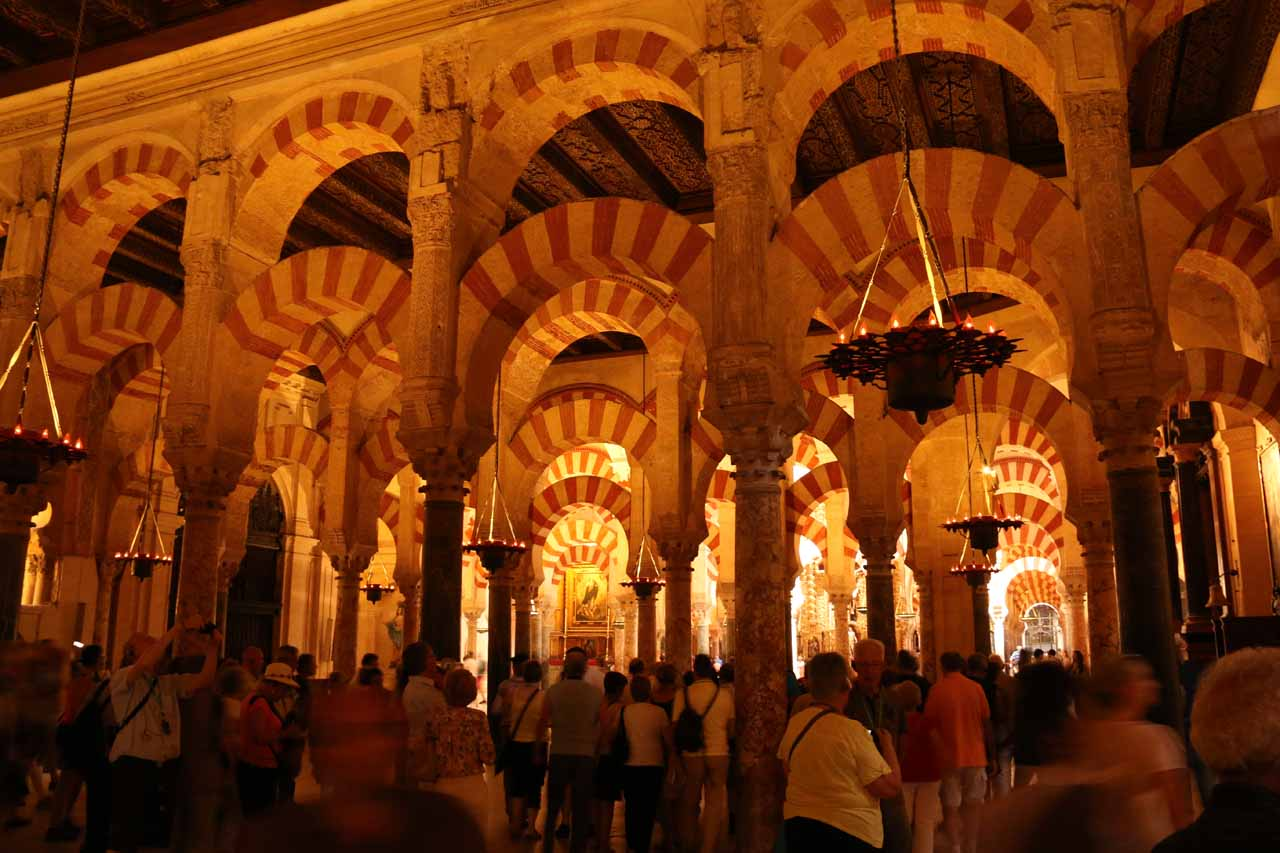 A huge crowd trying to get a photo of some kind of arch and prayer room at one end of la Mezquita