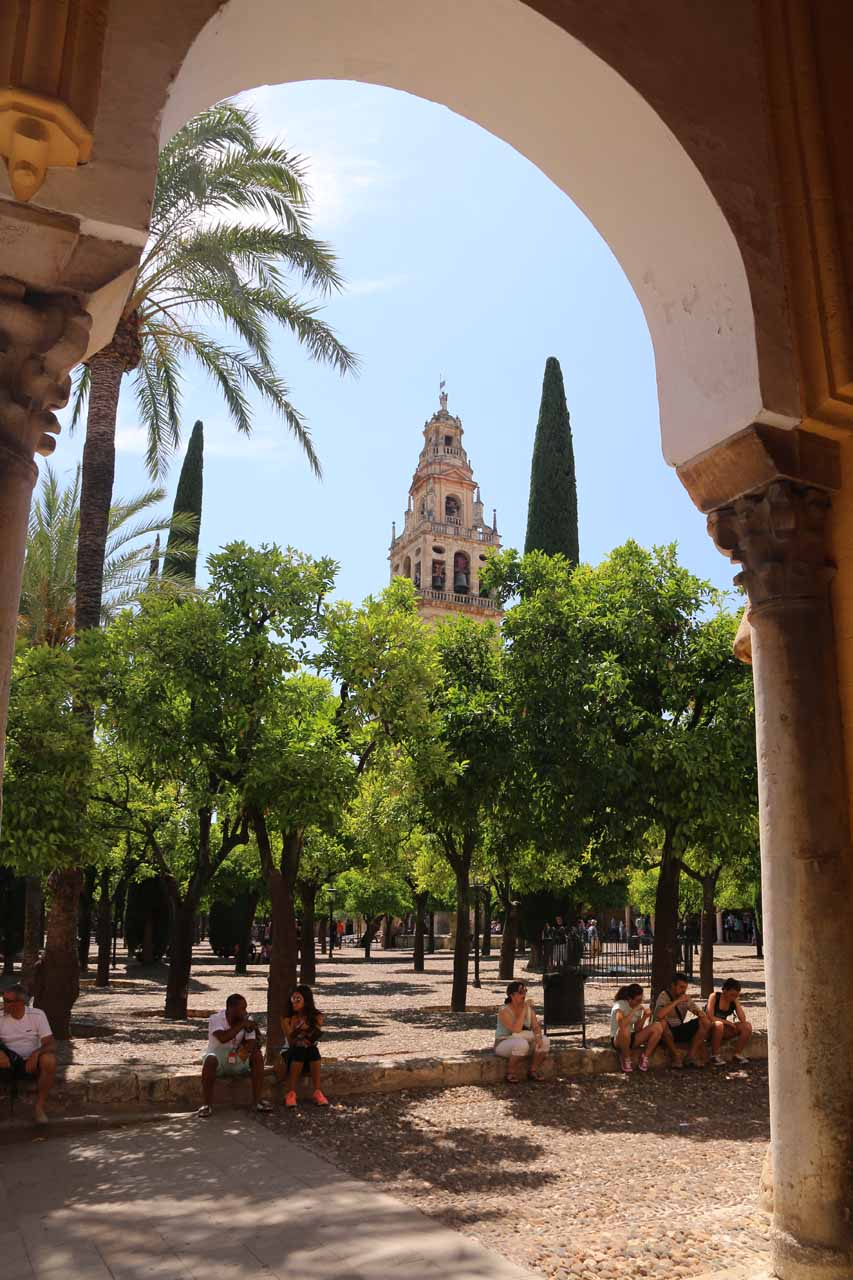 Looking beneath an Arabic arch towards the courtyard and bell tower of la Mezquita