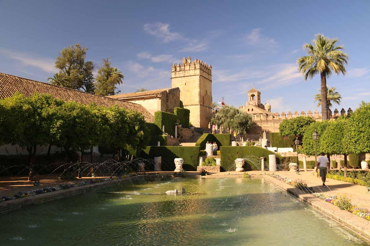 Looking across a fountain pond towards the Alcazar de los Reyes Cristianos from its garden