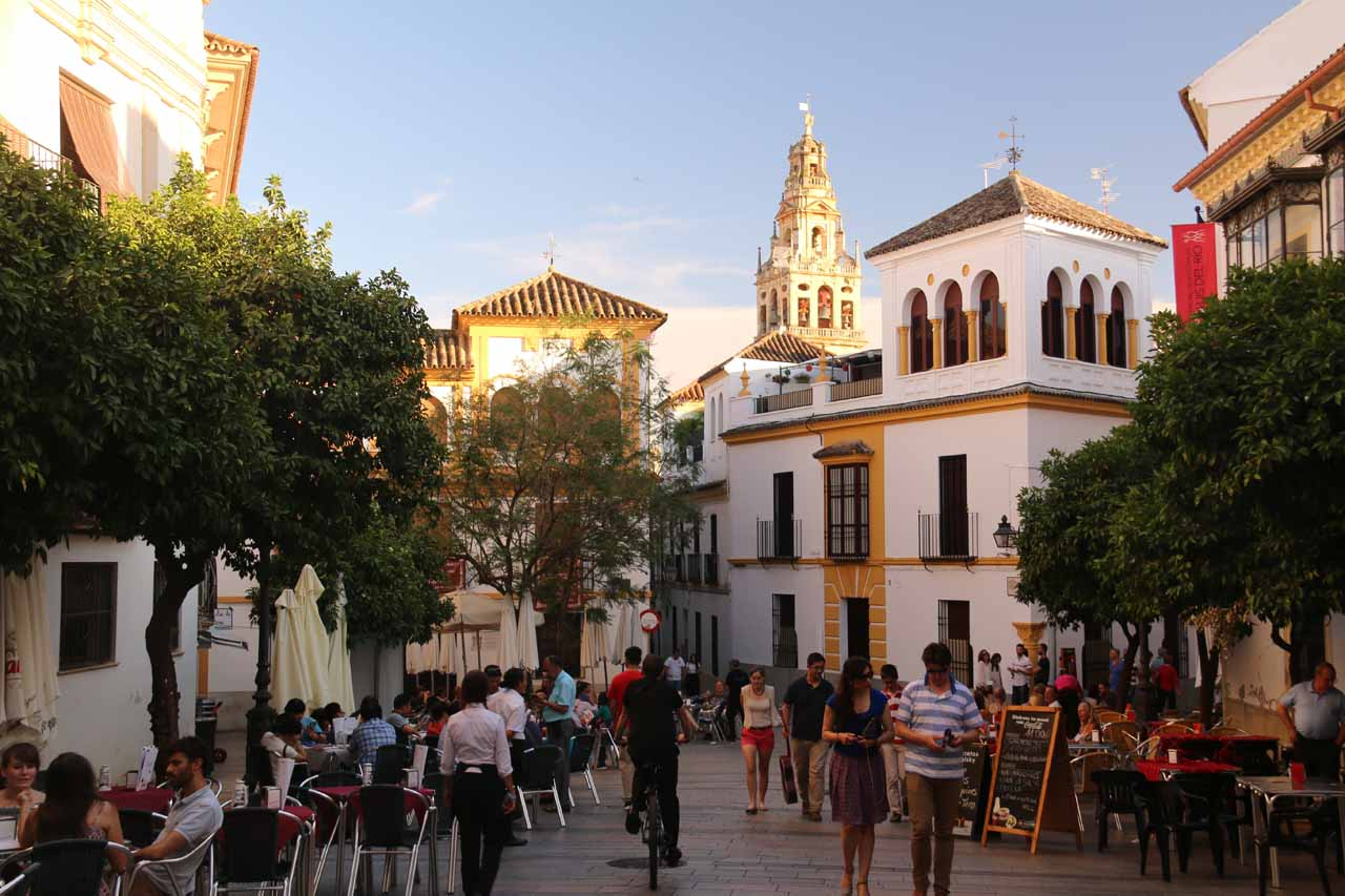 Strolling through a busy cafe area between Cespedes and Blanco Belmonte streets