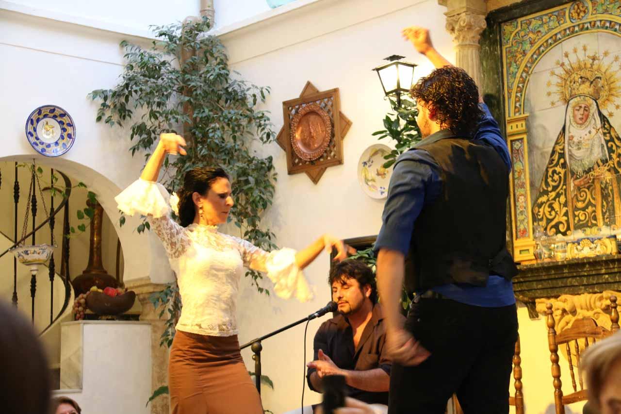 Enjoying the flamenco show while eating at the Patio de la Juderia