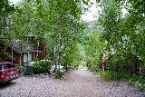 Cornet_Falls_061_07232020 - Passing back through the unpaved part of North Aspen Drive flanked by some homes near the trailhead for Cornet Falls