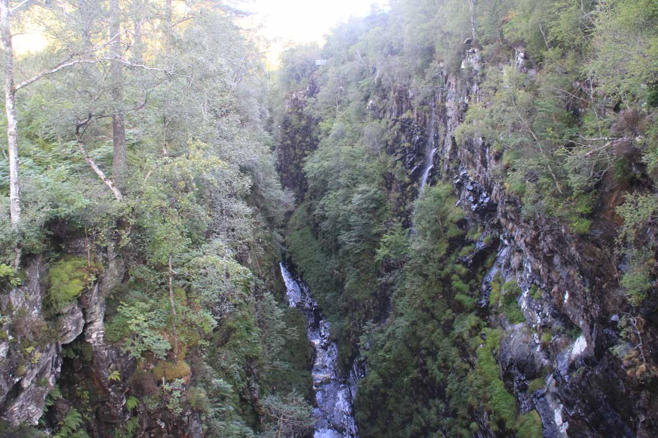 Looking downstream from the suspension bridge revealing the narrowness and the depth of the Corrieshalloch Gorge