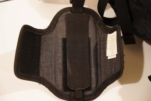 The velcro interior of the Cotton Carrier CCS G3 Strapshot Holster, which wraps around a shoulder strap on my pack