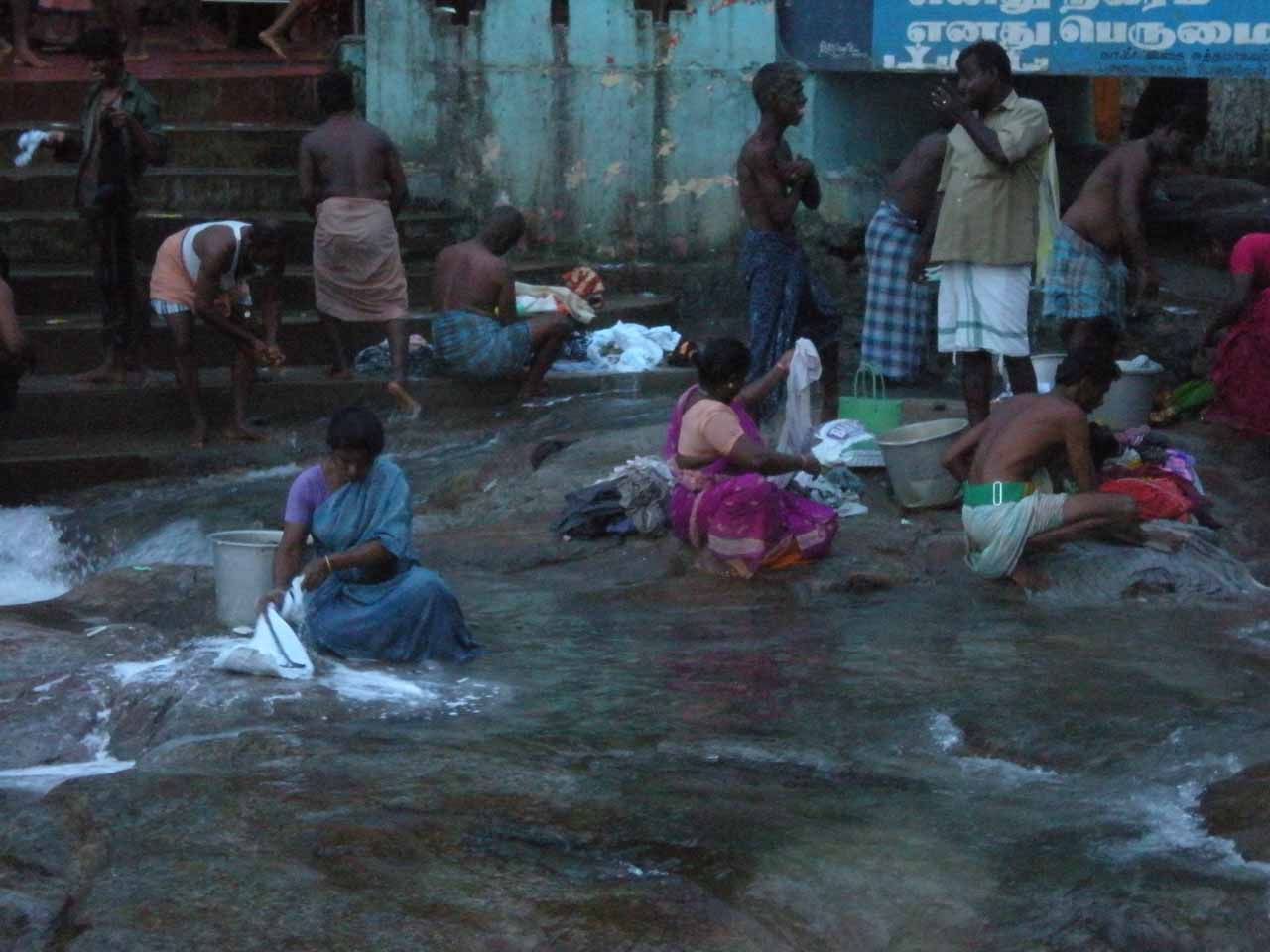 Some women washing clothes near the Courtallam Main Falls