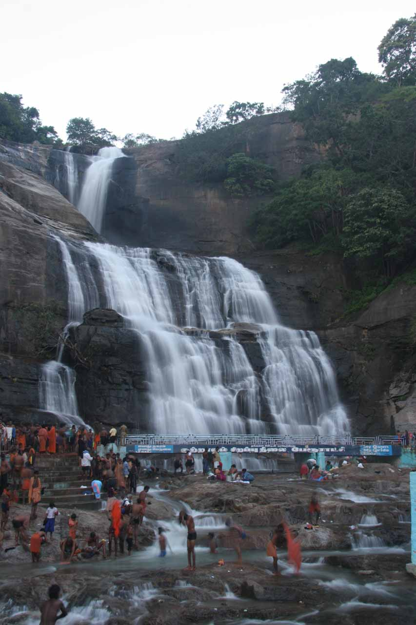 Portrait view of Courtallam Main Falls and the bevy of activity around it