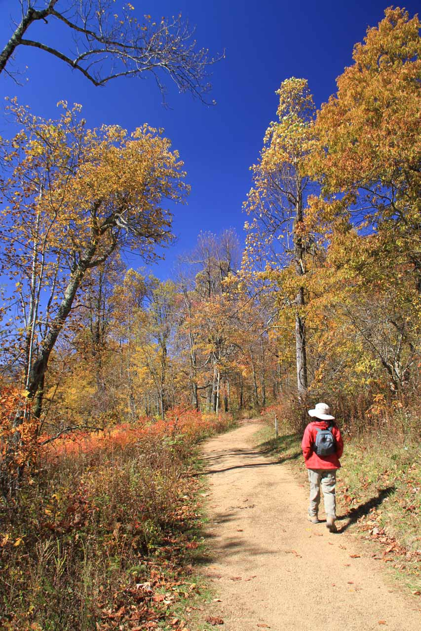 Julie on the trail between the visitor center and the campground