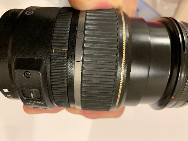 This cracked Canon zoom lens fell onto pavement when I dropped it while on a trip in New Zealand back in 2010