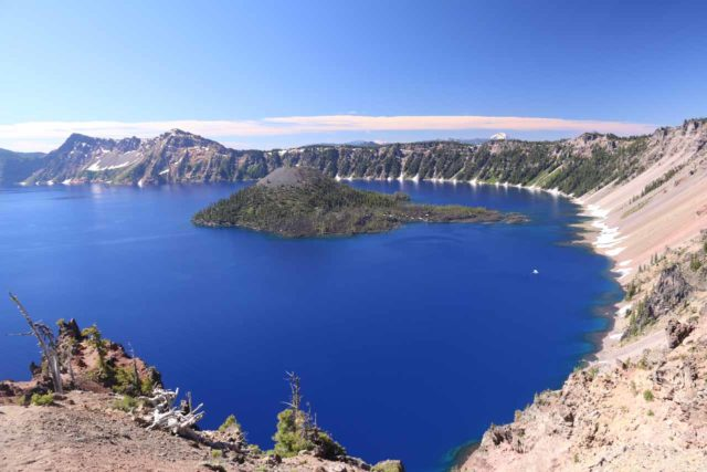 Crater_Lake_146_07152016 - Looking down at Crater Lake and Wizard Island from its northeast side of the rim, revealing the deep blue of the water (reflecting its clarity and depth) as well as the steepness of the crater rim
