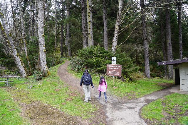 Crescent_Beach_032_04072021 - Julie and Tahia starting on the Crescent Beach Trail during our early April 2021 visit. That sign warned that only experienced hikers should do this trail, and I kind of see why