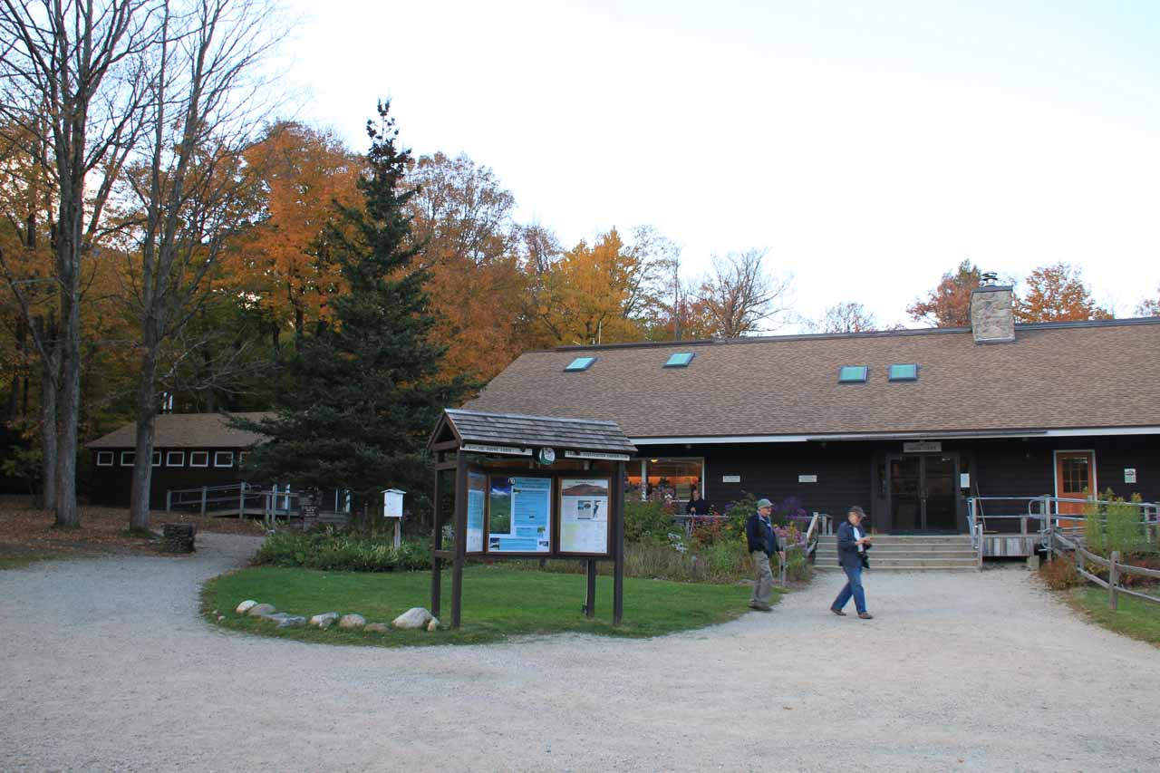 Looking at the entrance to the Pinkham Notch Visitor Center.  Notice the walkway to the left.  That's the way to the trail