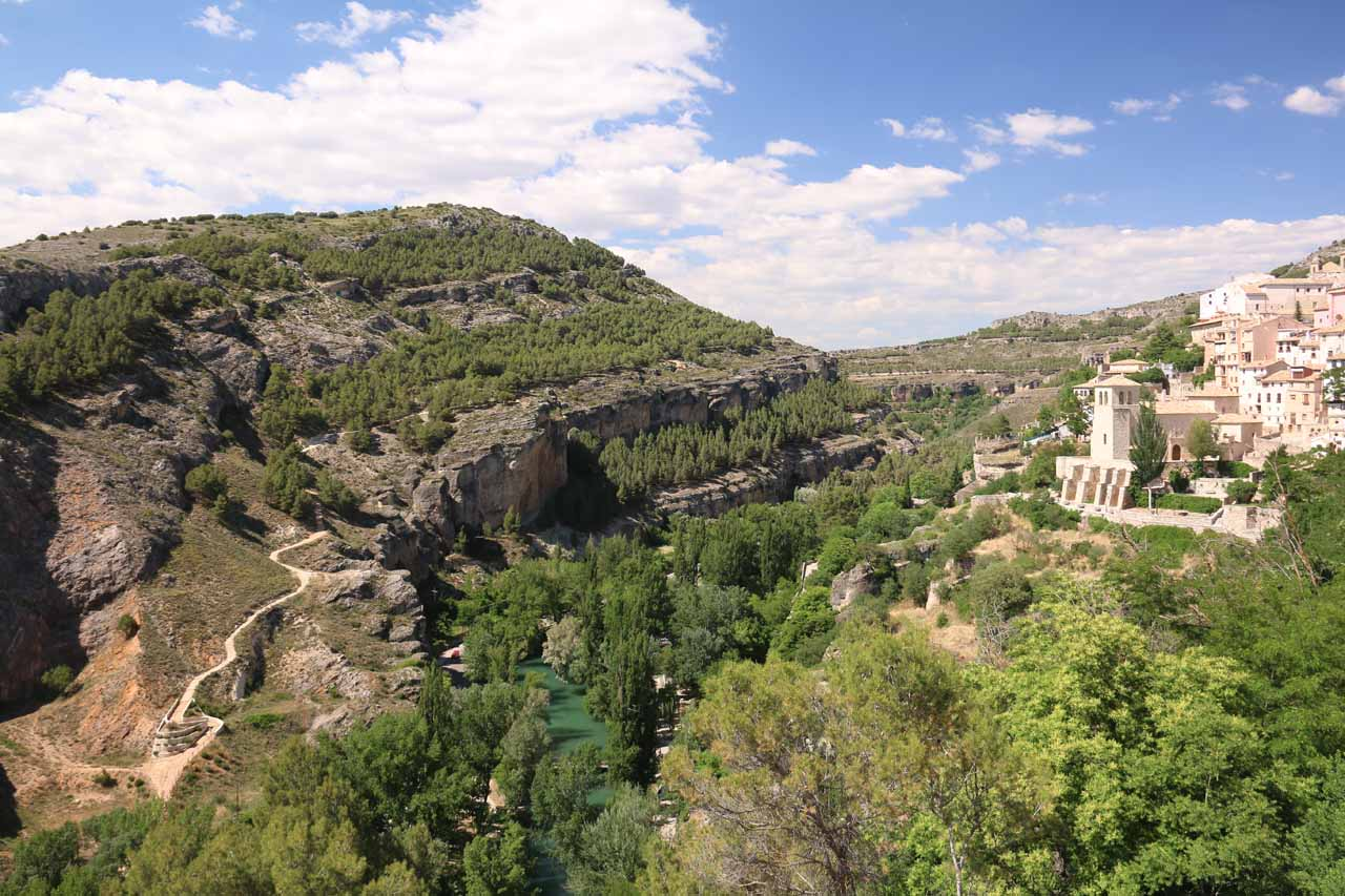 Panorama of the gorge and buildings clinging to it looking north from the Torre Mangana vicinity