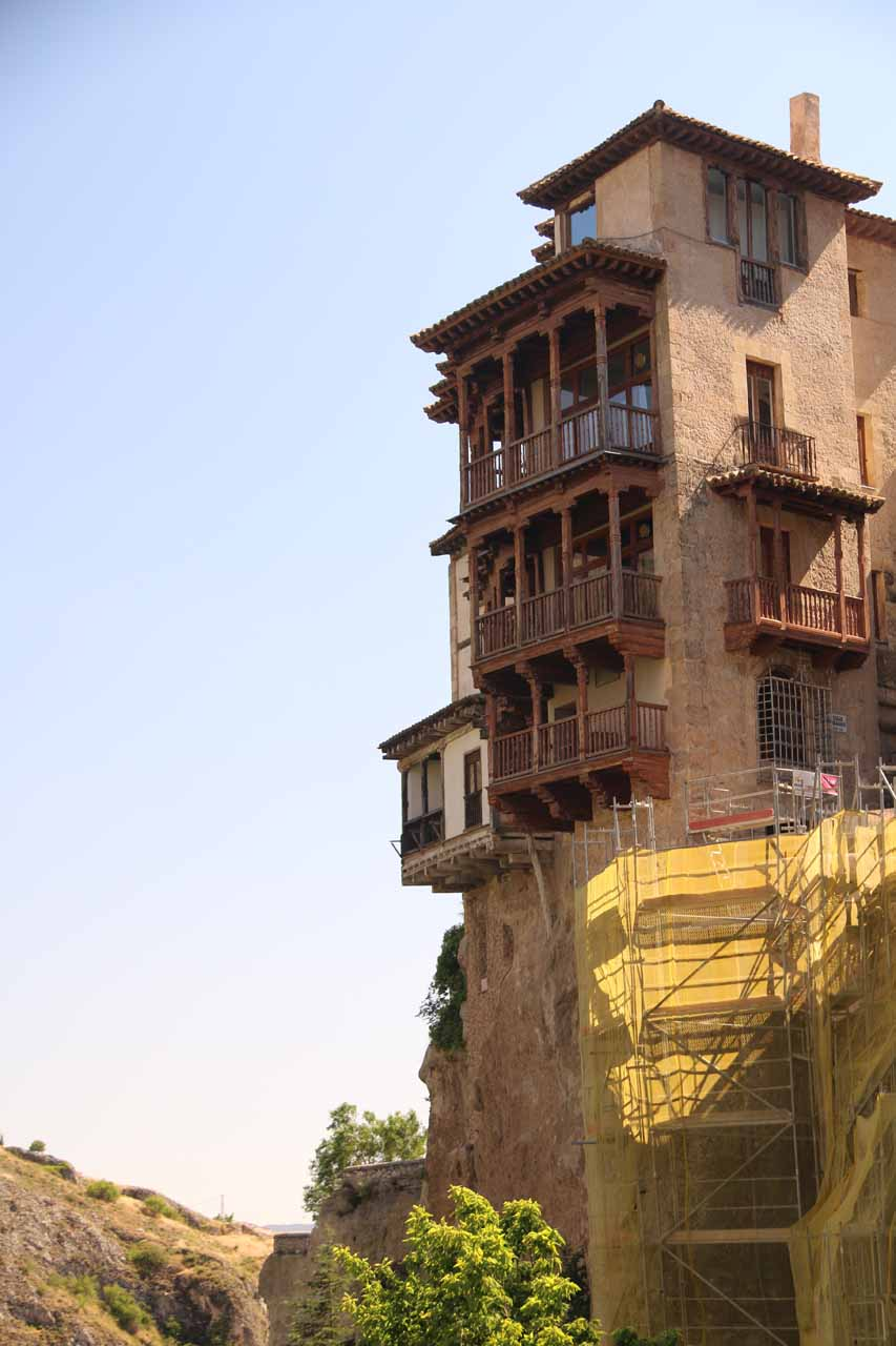 A closeup look at one of the Casas Colgadas with scaffoldings below it