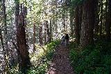 Curly_Creek_Falls_043_04052021 - Julie and Tahia continuing down the Lewis River Trail towards Miller Creek Falls