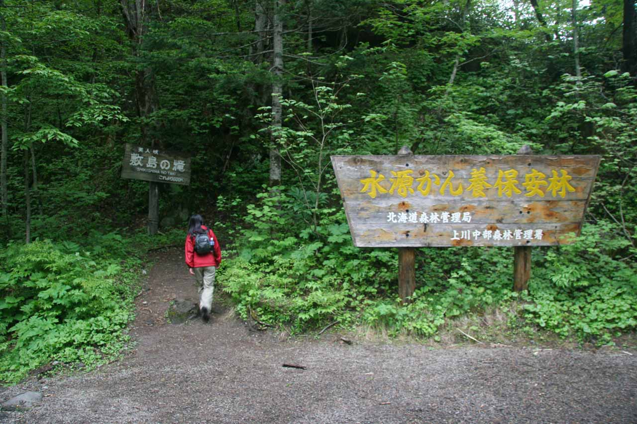 Julie following the signs and continuing the hike to the Shikishima Waterfall