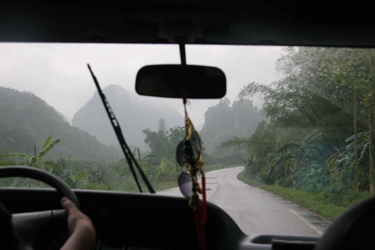 Driving into mountainous bush scenery under the rain