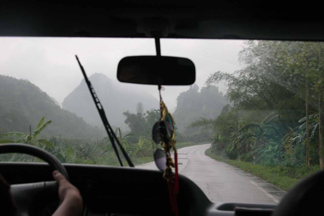 Driving into mountainous bush scenery under the rain