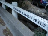 Deetjens_027_jx_03192010 - Checking out the bridge label over the Castro Canyon Creek