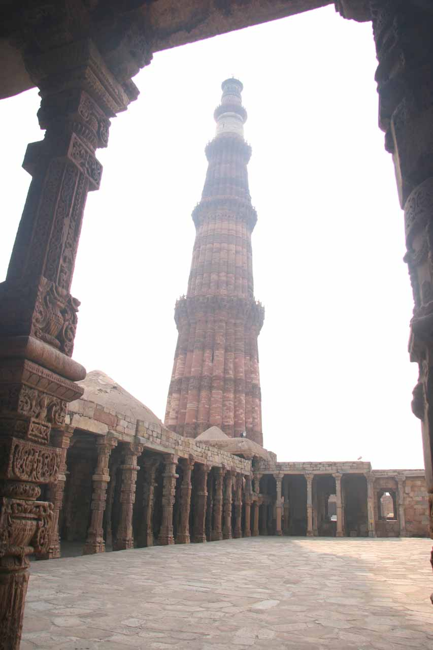 View of Qutb Minar from inside some fancy courtyard