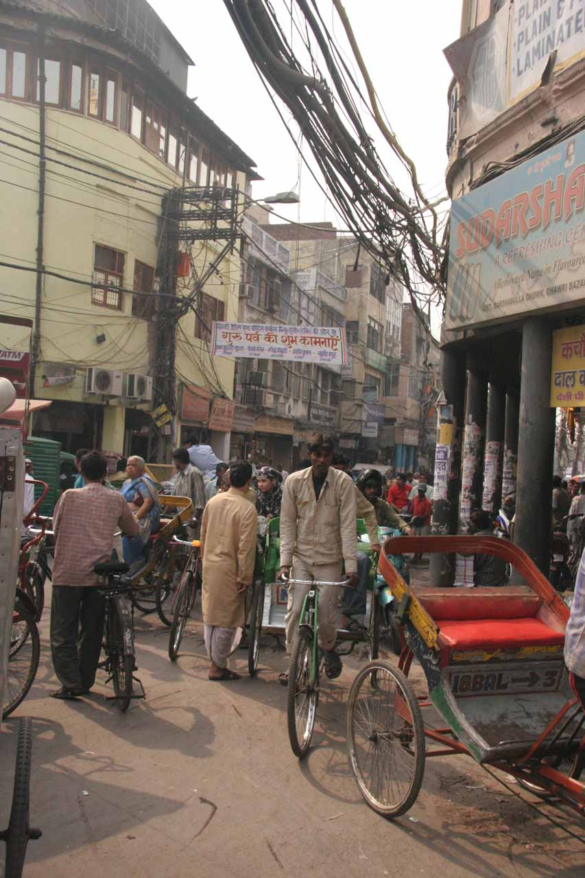 Weaving through the Chandni Chowk beneath dangerously entangled power lines