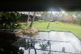 Denerau_004_11102019 - Looking out from the entrance to the reception in the Westin Fiji in Denerau under pouring rain