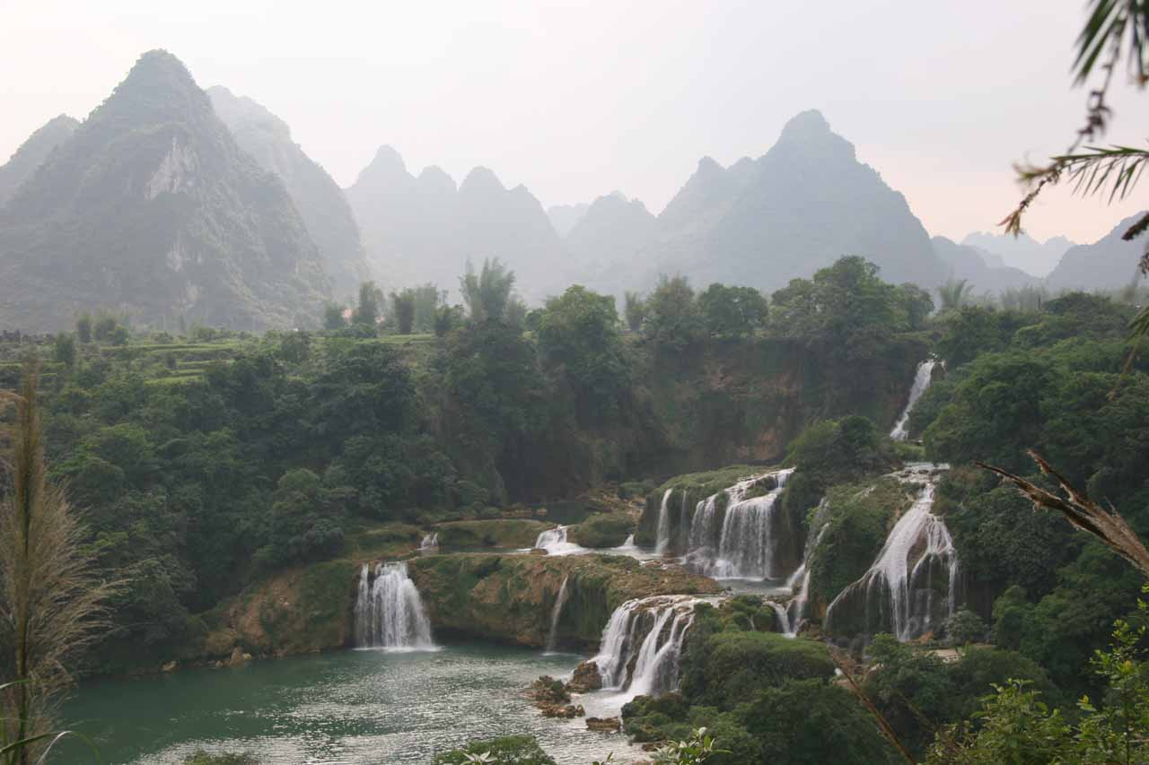 Detian Waterfall and the ghostly mountains backing the misty scene