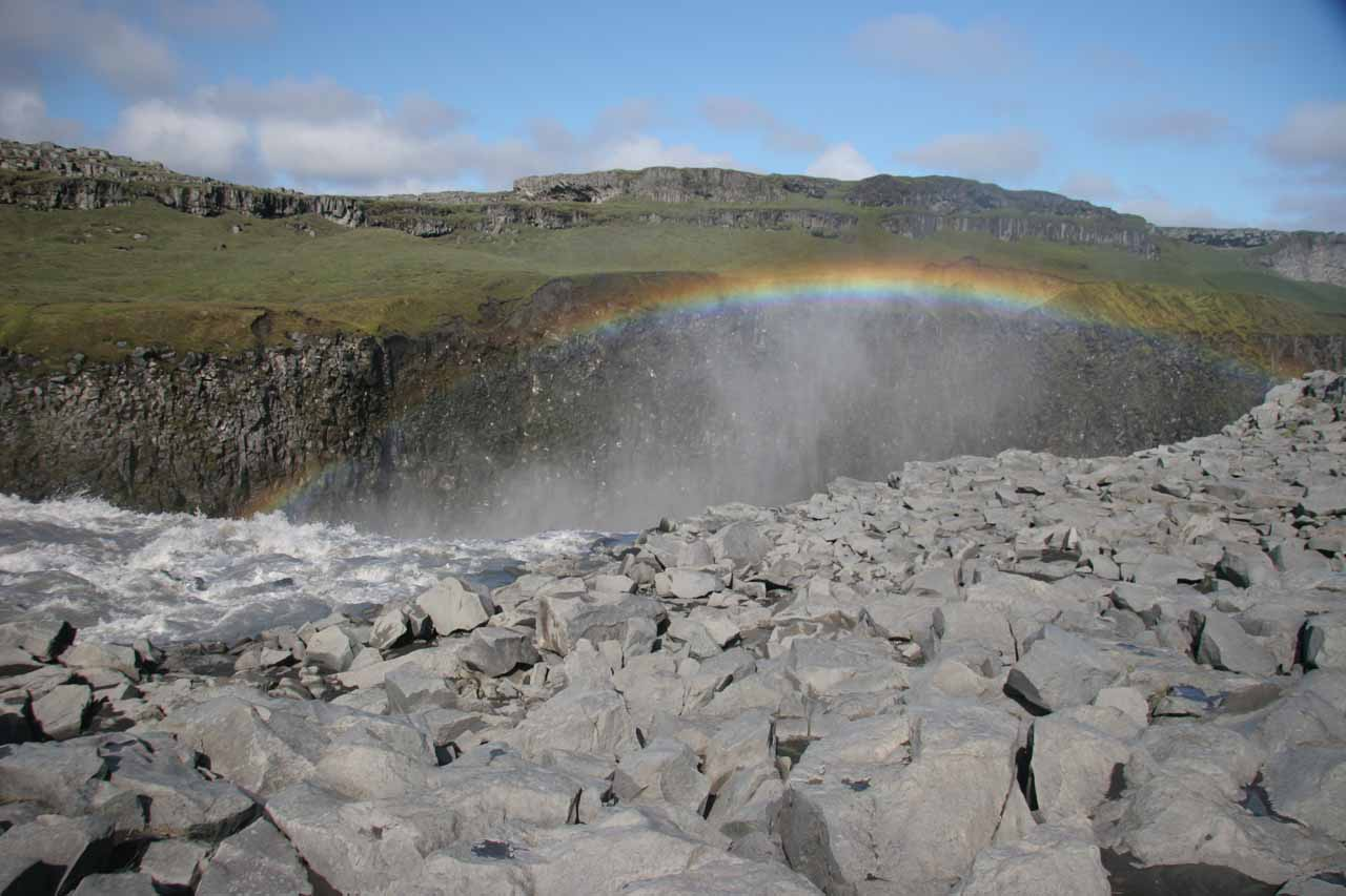 Looking downstream towards a full on rainbow over Dettifoss