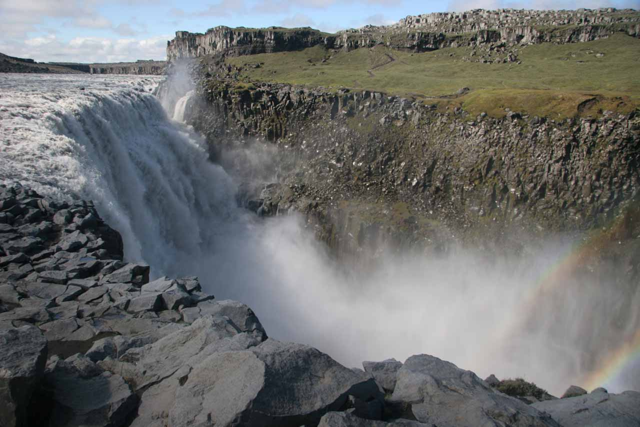 Looking across Dettifoss towards a partial double rainbow