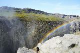 Dettifoss_062_08122021 - Looking downstream at a bold double rainbow with some people on the viewing platform on the west side of the canyon seen at the topleft of this photo taken during our August 2021 visit