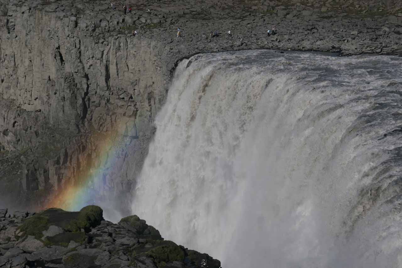 Bright rainbow near the brink of the west bank of Dettifoss
