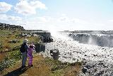 Dettifoss_154_08122021 - Julie and Tahia checking out the swollen state of Selfoss while trying to stay backed off from the precarious dropoffs on the east side