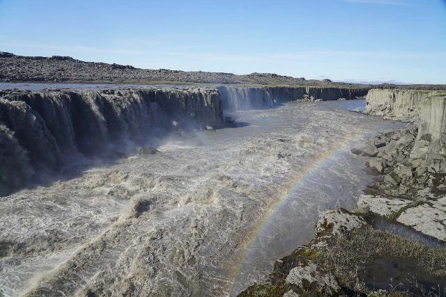 Dettifoss_165_08122021 - Looking downstream at the extent of the downstream extremities of a swollen Selfoss with an early afternoon rainbow appearing in the mist during our August 2021 visit