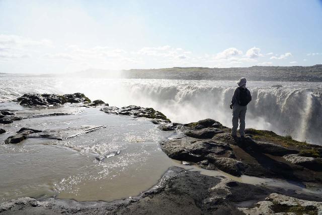 Dettifoss_170_08122021 - This was Julie standing near the brink of Selfoss when we came back in August 2021, but as you can see here, the flow was so great that we couldn't get up to the same spot that we did before