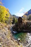 Devils_Punch_Bowl_Crystal_Mill_410_10172020 - Portrait look at the Crystal Mill and waterfall with colorful plunge pool and some remnant Fall colors in the tree opposite the mill