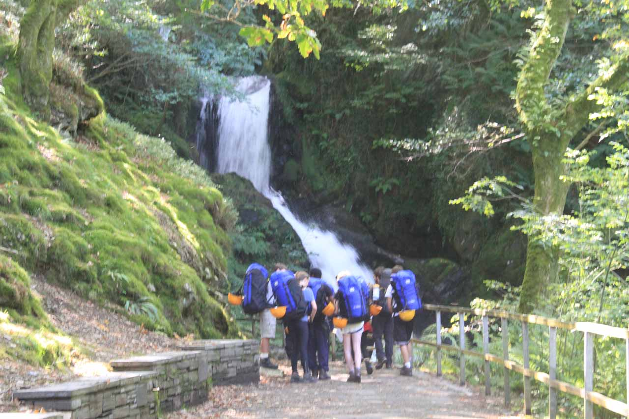 Looking back at a young caving group standing before the first Dolgoch Falls probably queuing up to go inside that first tunnel