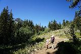 Donut_Falls_017_08092020 - Julie and Tahia climbing up towards a road crossing, where this road went to some campground