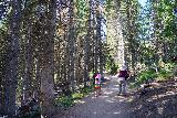 Donut_Falls_028_08092020 - Julie and Tahia getting some morning shade while hiking amongst the trees on the way up to the Donut Falls Trailhead during our mid-August 2020 visit