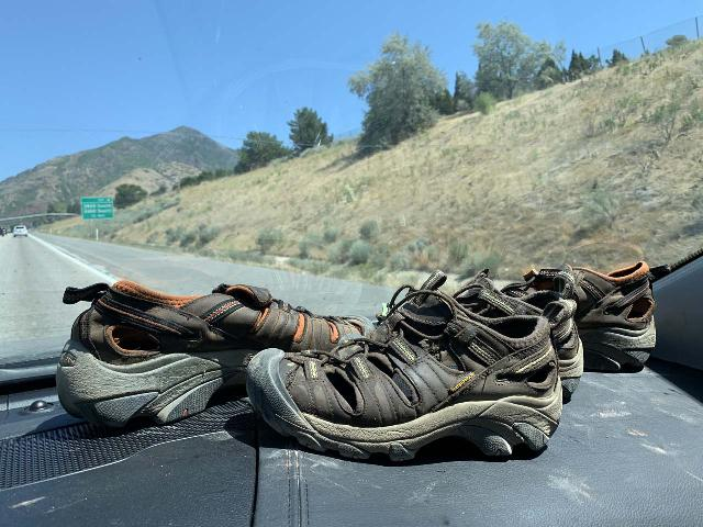 Trying to dry off our Keen Arroyo II shoes with the help of the sun while driving after a hike to Donut Falls near Salt Lake City, but they really made the car smell