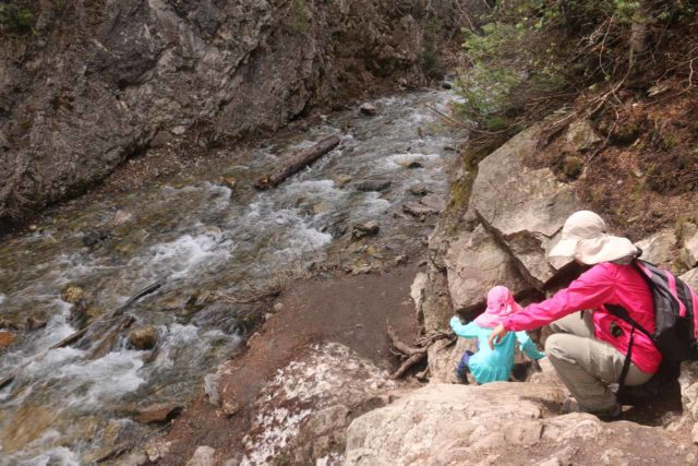 Donut_Falls_053_05262017 - Tahia and Julie negotiating a little bit of a sit and scoot scramble in order to access the Mill D South Fork Creek towards Donut Falls