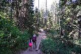 Donut_Falls_064_08092020 - Julie and Tahia following along the Donut Falls Trail, which meandered through more forest