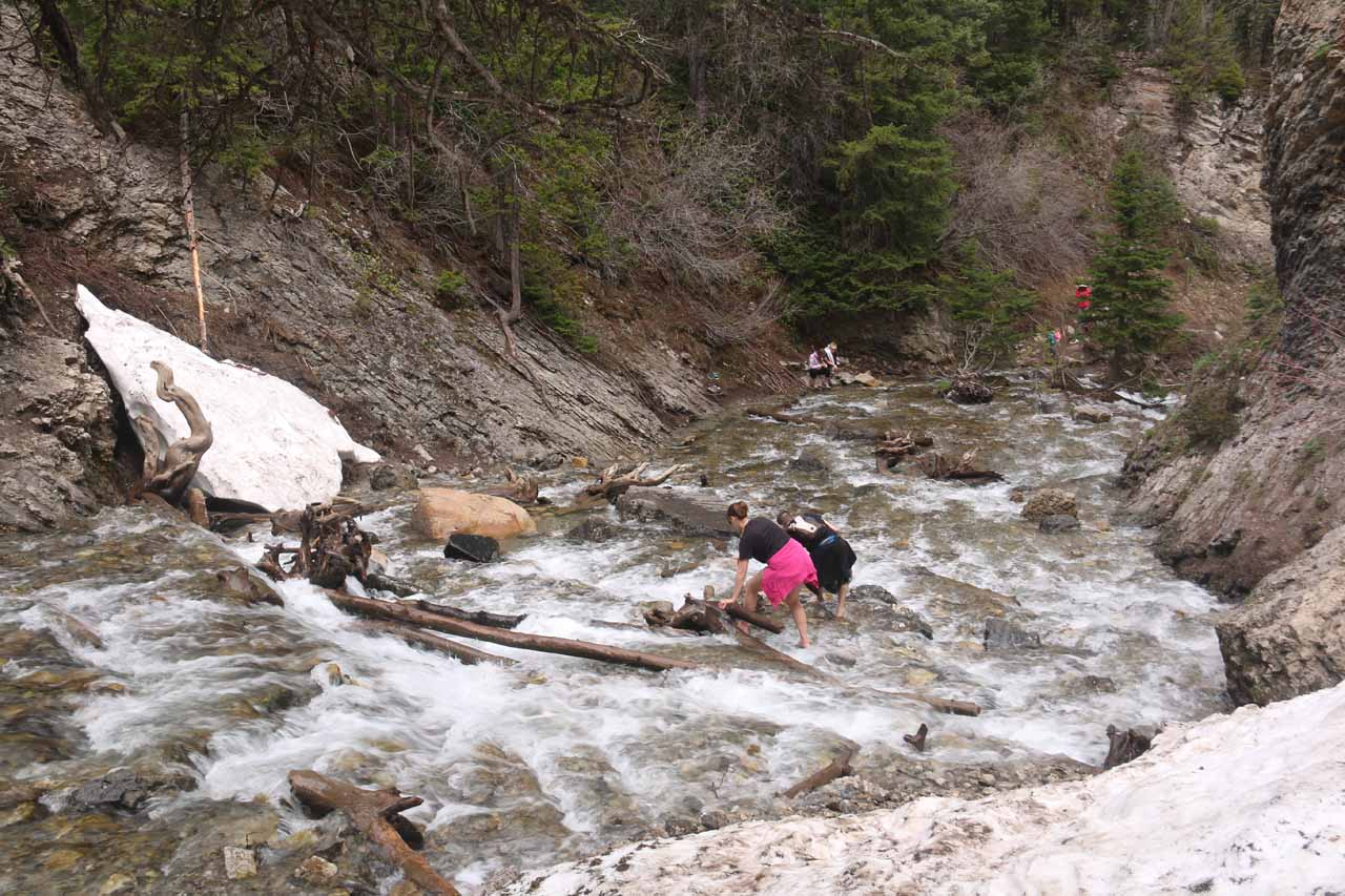 Looking back at a couple who was going back across the Mill D South Fork after having their fill of the opposite side of the creek