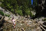 Donut_Falls_244_08092020 - Julie and Tahia scrambling back downstream as we started to leave the Donut Falls area on our mid-August 2020 visit