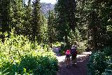 Donut_Falls_259_08092020 - Julie and Tahia making it back to the footbridge over the Mill D South Fork on our way back from Donut Falls in mid-August 2020