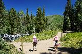 Donut_Falls_276_08092020 - Julie and Tahia walking towards the parking lot at the Donut Falls Trailhead