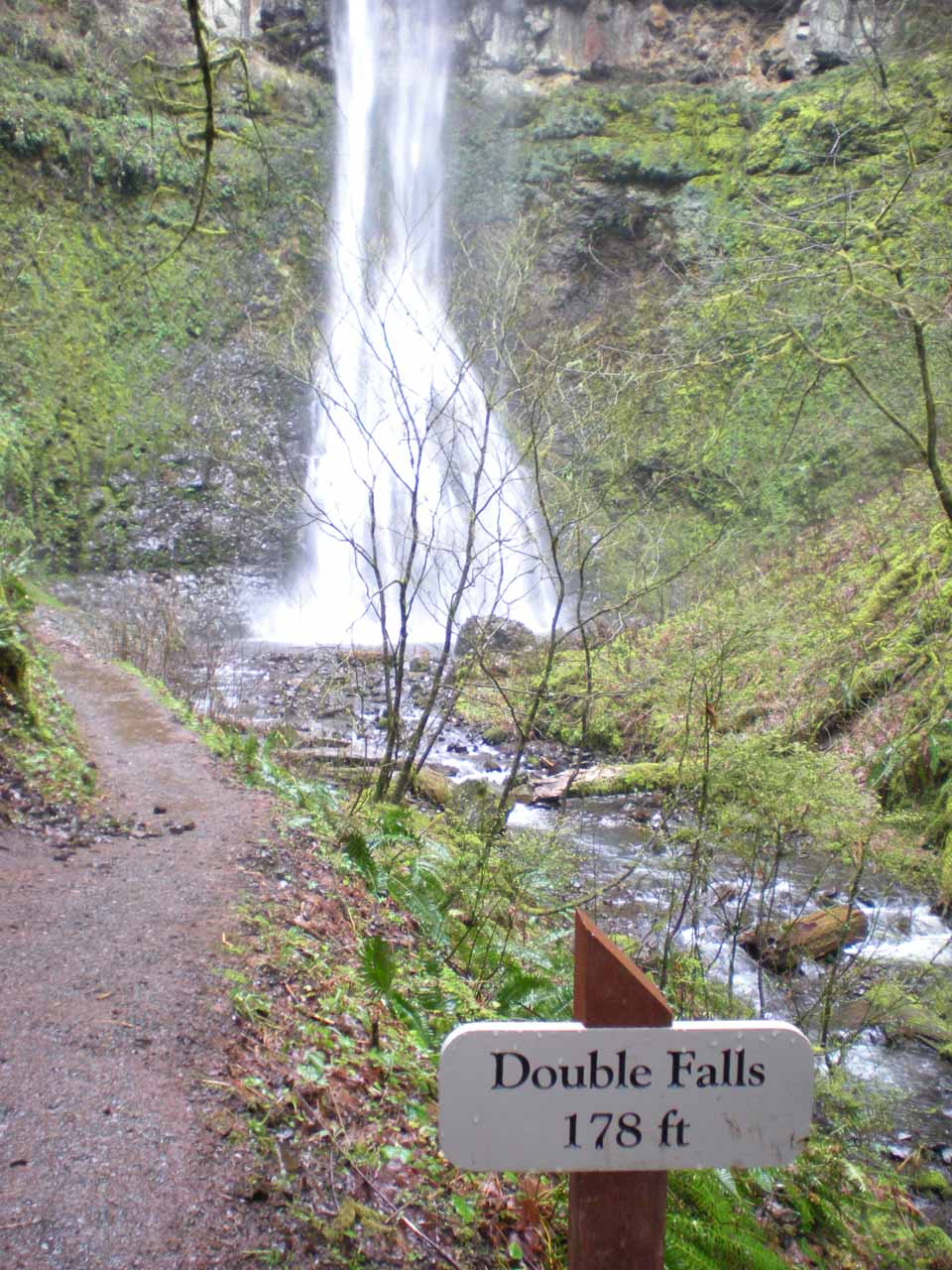 Double Falls fronted by a sign indicating its height