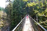 Drift_Creek_Falls_048_04082021 - Julie and Tahia walking across the bouncy Drift Creek Suspension Bridge
