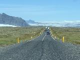 Drive_to_Fjallsarlon_006_iPhone_08082021 - Lots of traffic still in either direction in front of the Fjallsjokull and the neighboring branch of Vatnajokull