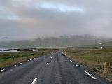 Drive_to_Kirkjufellsfoss_sunset_006_iPhone_08172021 - Looking at the context of that roadside cascade behind the Mavahlið Farm while driving east on the Road 54 under cloudy skies in August 2021